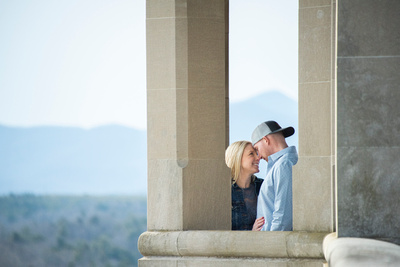Couple having a sweet moment on the south terrace at Biltmore Estate in Asheville during their engagement photos