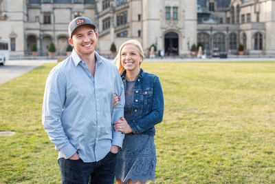 Engaged couple on the front lawn at Biltmore Estate in Asheville
