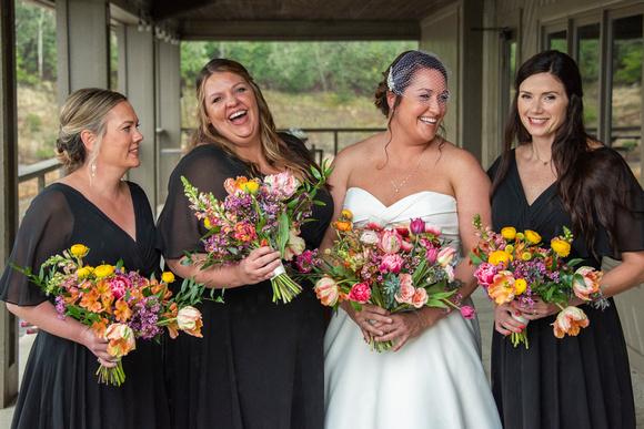 Bride and bridesmaids laughing at Connestee Falls wedding