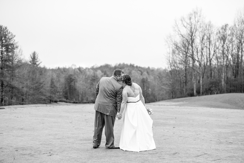 Bride and groom kissing at Connestee Falls wedding