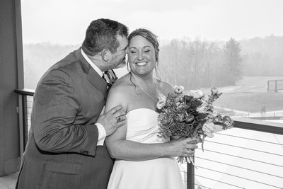 Bride and groom portrait in black and white during rainy day wedding at Connestee Falls
