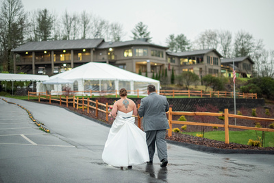 Bride and groom walking to reception at Connestee Falls wedding