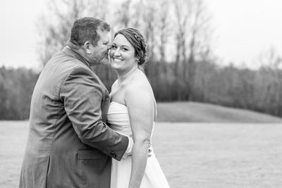 Bride looking at the camera at Connestee Falls wedding