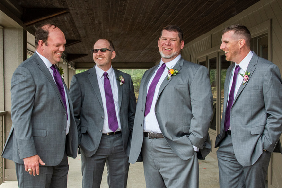 Groom and groomsmen laughing at Connestee Falls wedding