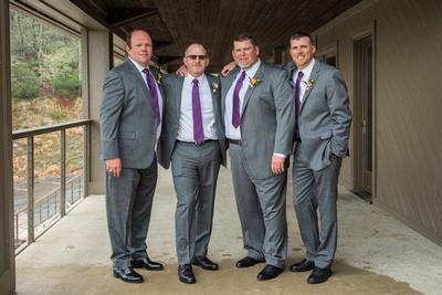 Groom and groomsmen on rainy day at Connestee Falls wedding
