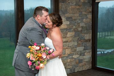 Groom kisses bride on cheek during Connestee Falls wedding