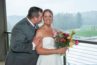 Groom nuzzling bride at Connestee Falls wedding