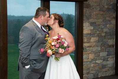 Indoor portrait of bride and groom at Connestee Falls wedding