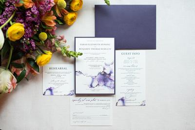 Invitation suite in purple watercolor at Connestee Falls wedding