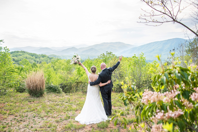 Bride and groom celebrating at Something Blue Mountain Venue near Asheville NC