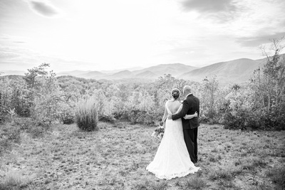 Bride and groom looking out at mountains at Something Blue Mountain Venue near Asheville NC
