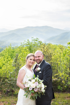 Bride and groom portrait in the mountains at Something Blue Mountain Venue near Asheville NC