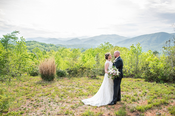 Bride and groom portrait with mountain views at Something Blue Mountain Venue in Marion NC