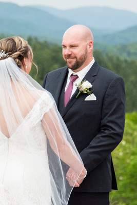 Groom during ceremony at Something Blue Mountain Venue near Asheville NC