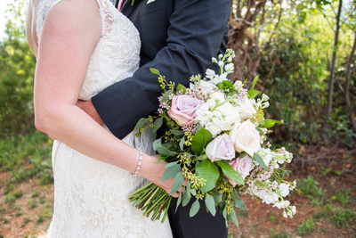 Wedding bouquet by It Can Be Arranged held br bride at Something Blue Mountain Venue in Marion NC