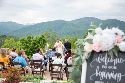 Wedding ceremony surrounded by mountains at Something Blue Mountain Venue in Marion NC