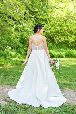 Back of brides dress at botanical gardens before wedding the Grand Bohemian Hotel in Asheville NC
