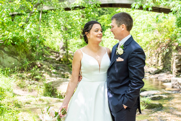 bride and groom portrait next to creek at botanical gardens before wedding the Grand Bohemian Hotel in Asheville NC