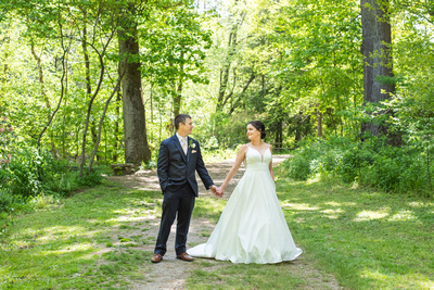Couple holding hands at botanical gardens before wedding at the Grand Bohemian Hotel in Asheville NC