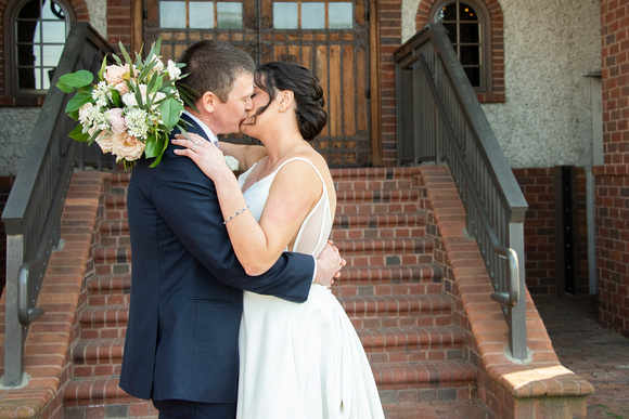 Couple kissing at wedding in front of the Grand Bohemian Hotel in Asheville NC