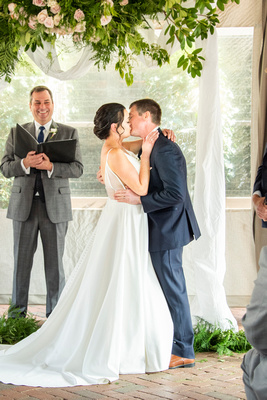 Couple kissing at wedding the Grand Bohemian Hotel in Asheville NC
