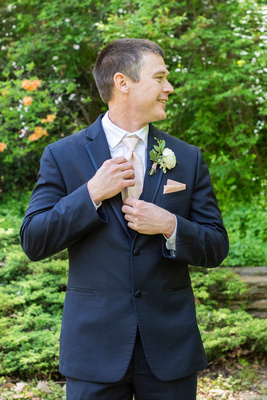 Groom portrait at botanical gardens before wedding the Grand Bohemian Hotel in Asheville NC