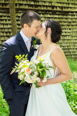 the Grand Bohemian Hotel in Asheville NC with couple kissing at the Botanical Gardens