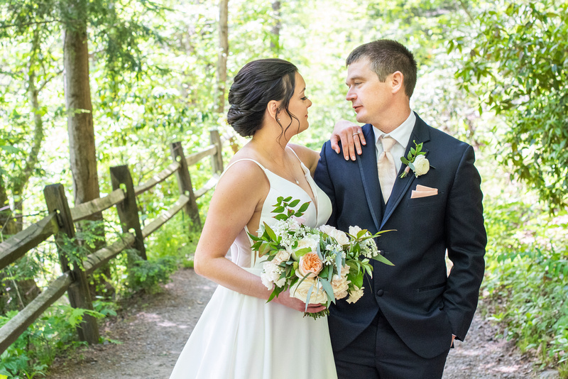 Wedding couple looking at each other at botanical gardens before wedding at the Grand Bohemian Hotel in Asheville NC