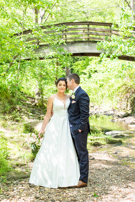 wedding portait along creek at botanical gardens before wedding the Grand Bohemian Hotel in Asheville NC