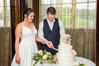 bride and groom cut cake at the Grand Bohemian Hotel in Asheville NC