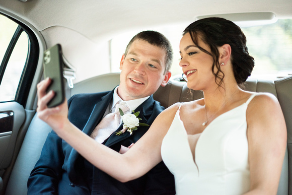 bride and groom in limo taking selfie at the Grand Bohemian Hotel in Asheville NC