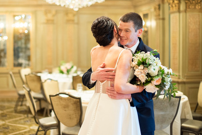 first look hug at wedding at the Grand Bohemian Hotel in Asheville NC