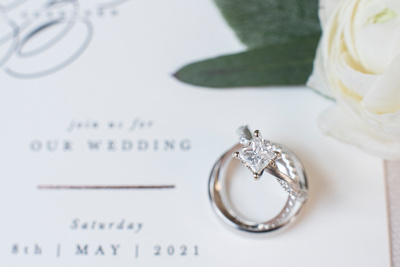 Wedding rings on invitaion at the Grand Bohemian Hotel in Asheville NC