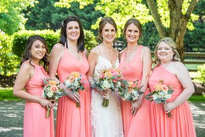 Bride and bridesmaids in coral at Hawkesdene in Andrews, NC