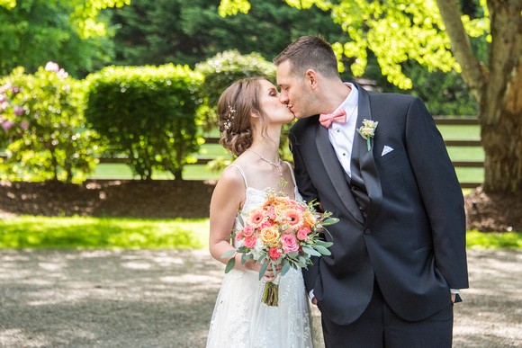 Bride and groom kissing at Hawkesdene in Andrews, NC