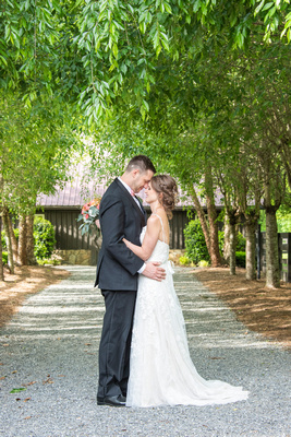 Bride and groom touching foreheads at Hawkesdene in Andrews, NC near Asheville