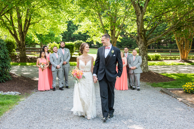 Bride and groom walking in front of wedding party at Hawkesdene in Andrews, NC