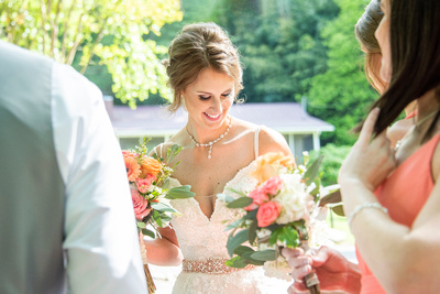 Bride smiling after wedding ceremony at Hawkesdene in Andrews, NC