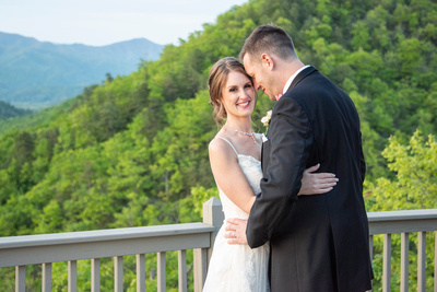 Bride looking at me on mountaintop at Hawkesdene in Andrews, NC near Asheville