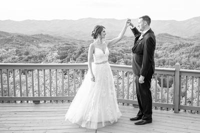 Groom twirling bride on mountain top at Hawkesdene in Andrews, NC