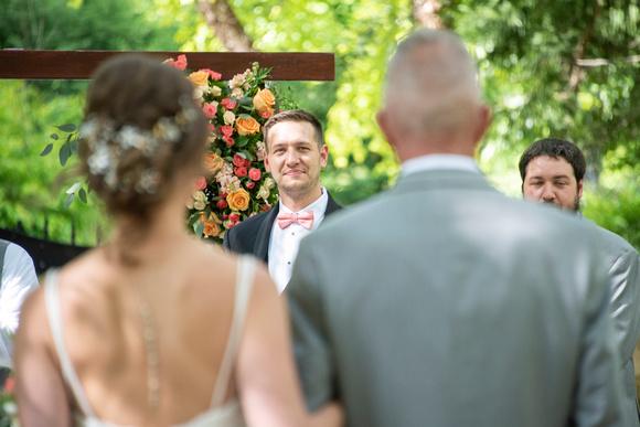 Grooom looking at bride walk down the aisle at wedding at Hawkesdene in Andrews, NC
