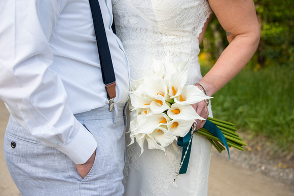 Bride and groom holding wedding bouquet at wedding at AirBnb in Burnsville NC near Asheville NC