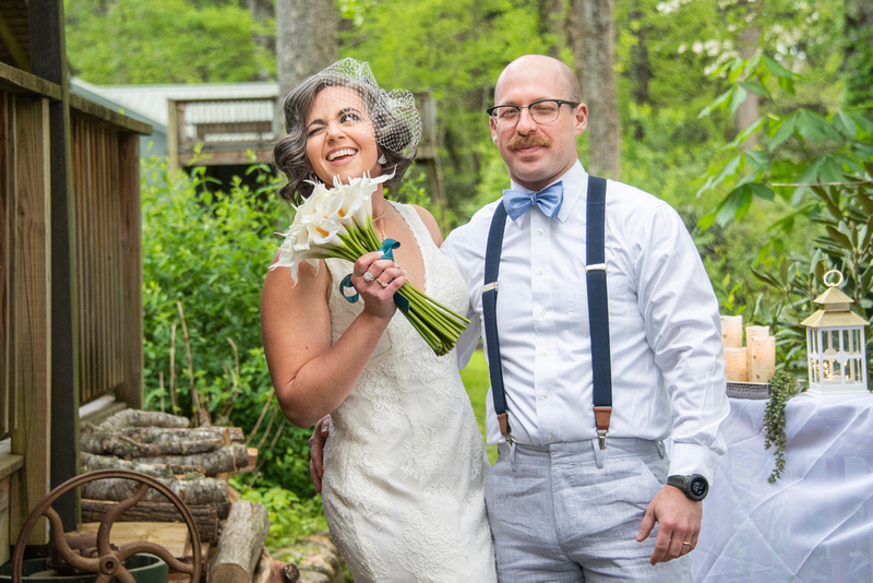 Bride winking at brest friend after wedding ceremony at AirBnb in Burnsville NC near Asheville NC