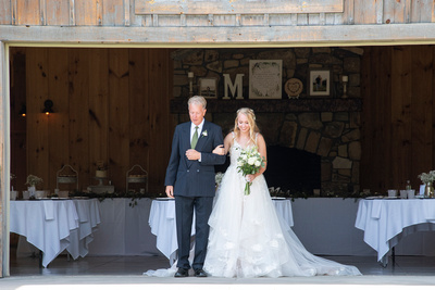 Bride and father walking down the aisle at Claxton Farm in Weaverville, near Asheville, NC