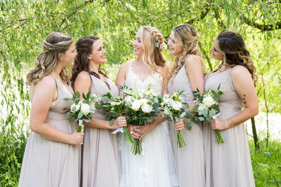 Bride and bridesmaids at wedding at Claxton Farm in Weaverville, near Asheville, NC