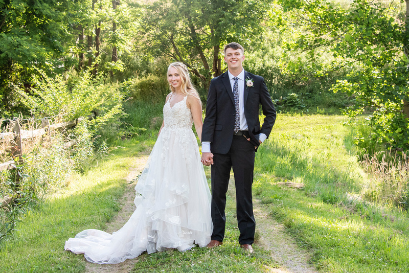 Bride and groom holding hands at Claxton Farm in Weaverville, near Asheville, NC