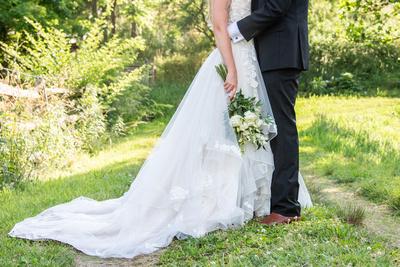 Bride and grooom wedding attire at Claxton Farm in Weaverville, near Asheville, NC