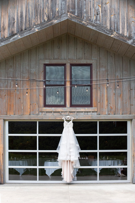 Brides dress hanging at Claxton Farm in Weaverville, near Asheville, NC