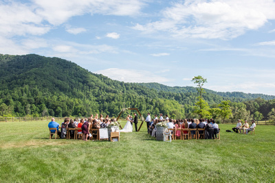 Wedding ceremony with mountain views at Claxton Farm in Weaverville, near Asheville, NC
