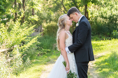 Wedding couple touching noses at Claxton Farm in Weaverville, near Asheville, NC